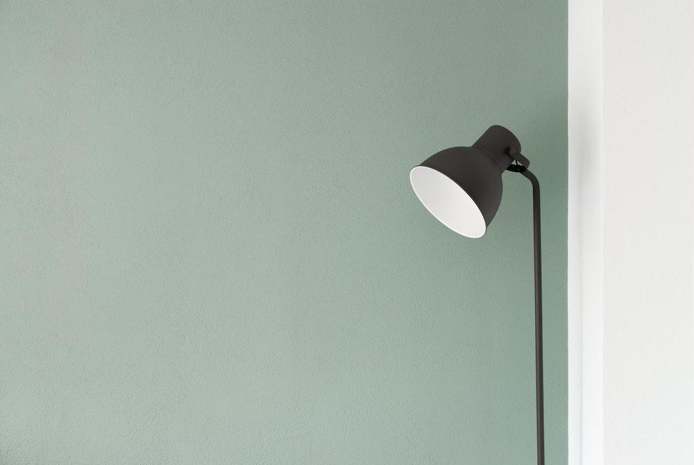black floor lamp at the corner