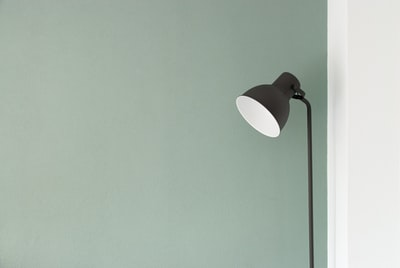 black floor lamp at the corner design teams background