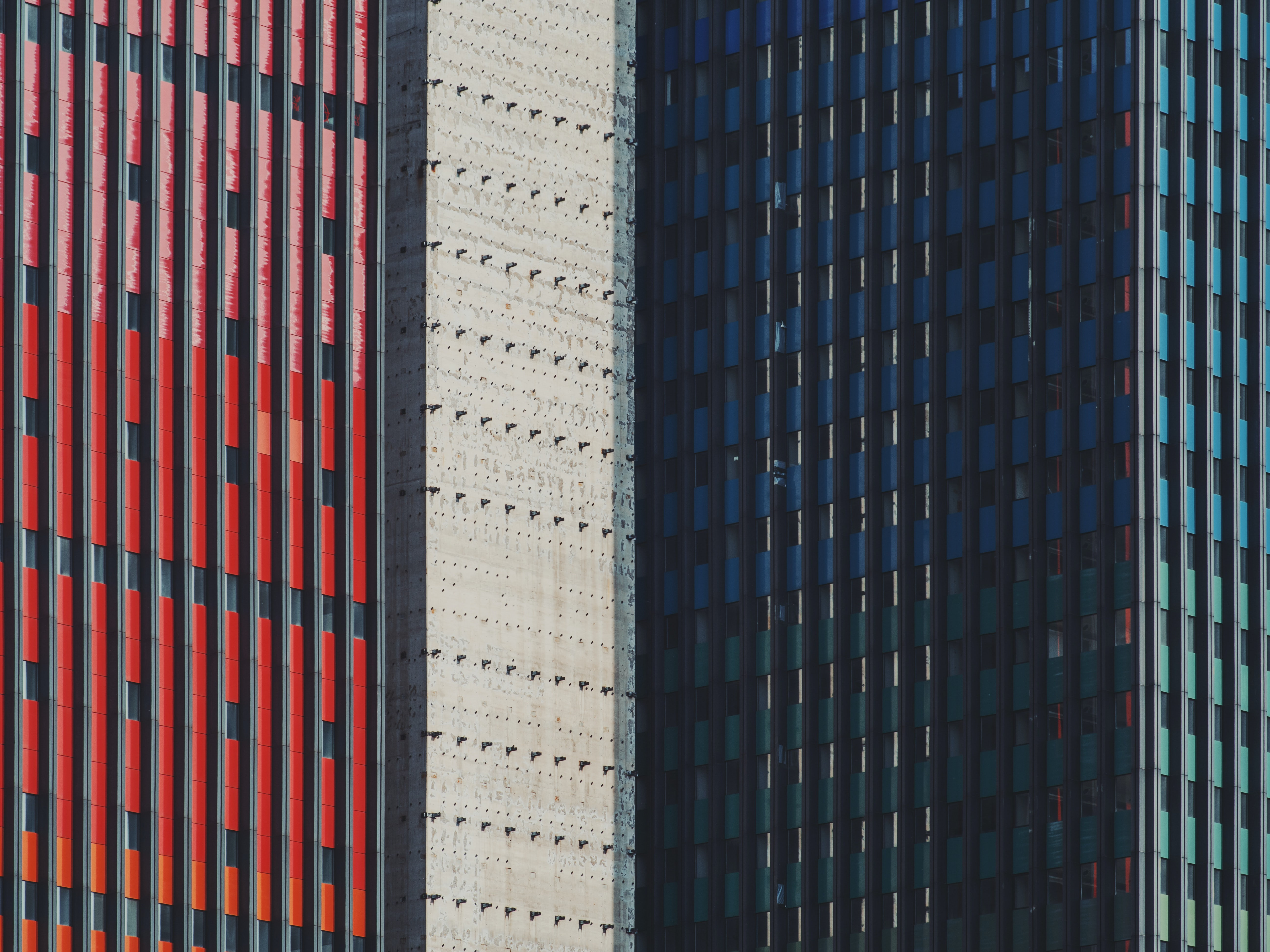 blue, white, and red commercial buildings