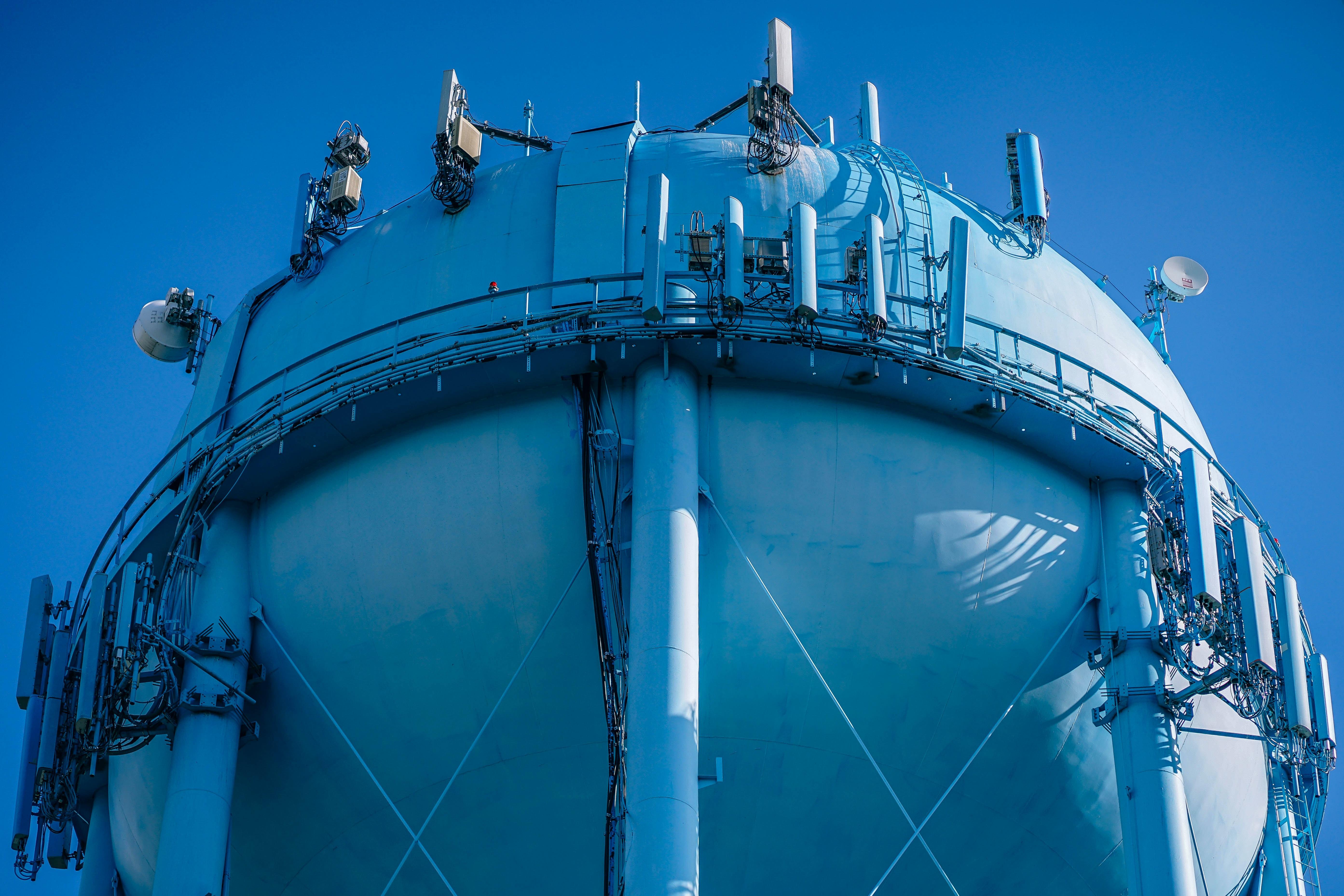 low angle photo of blue metal tank