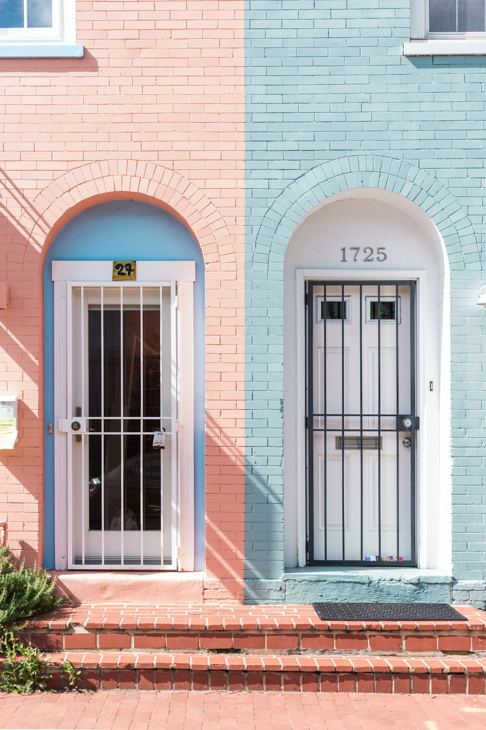 two white wooden doors with grills