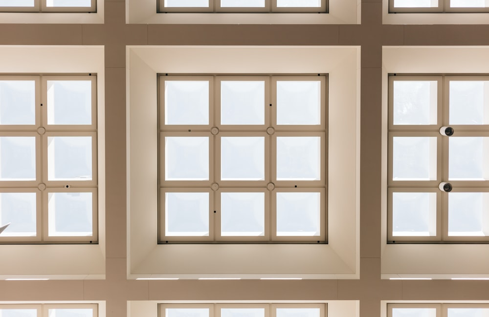 closeup photo of white and brown paneled frame lot