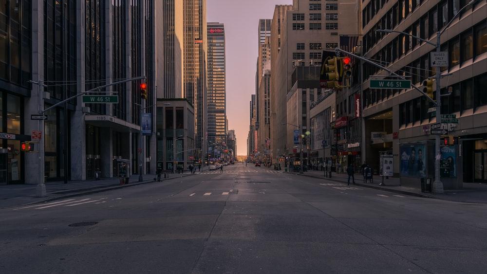 gray concrete road between buildings