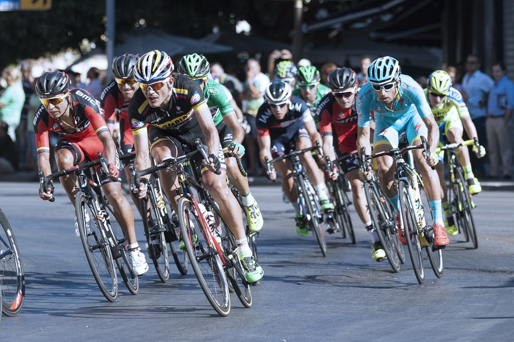 group of men on cycling race