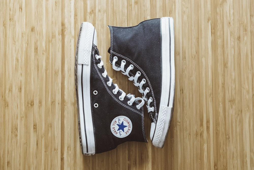 pair of black Converse All-Star high-top 7bc22f349
