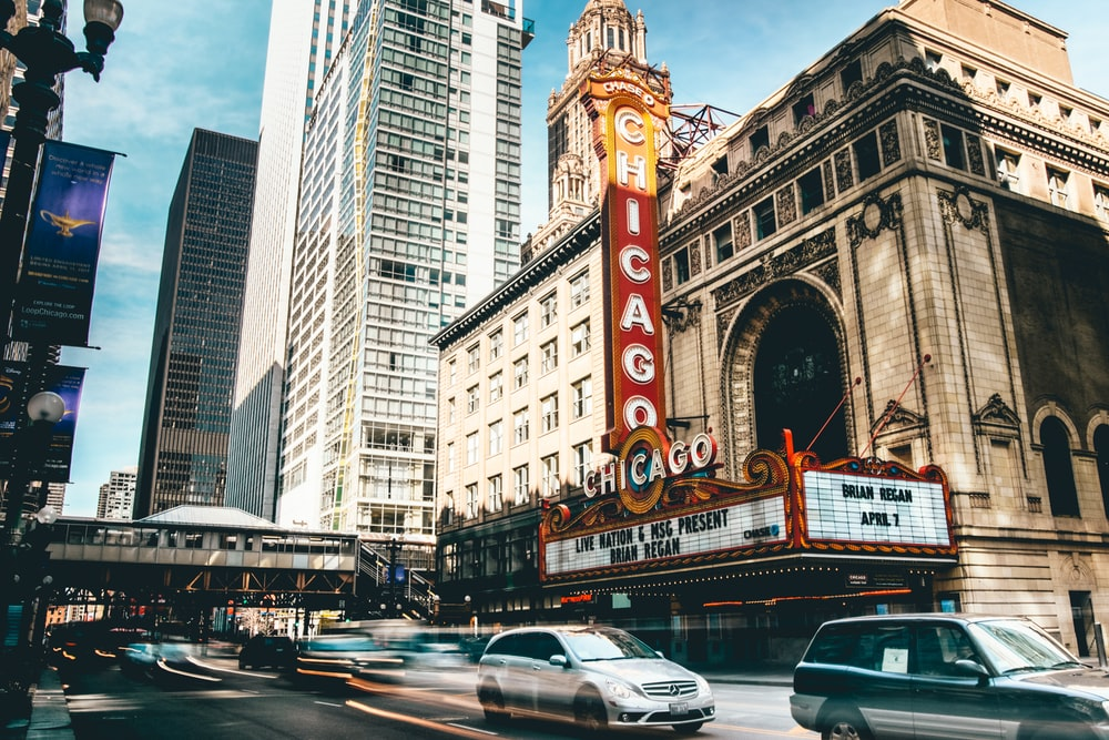 Chicago Theater in time lapse photography during daytime