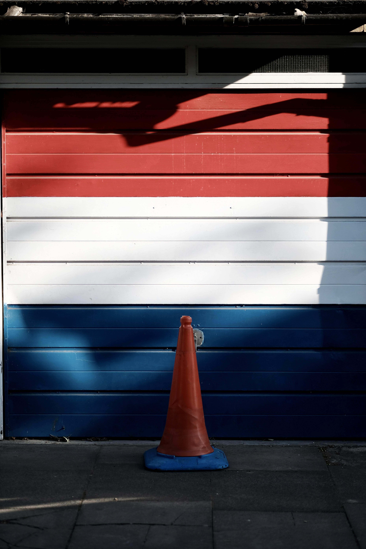 red, white , and blue wooden garage door