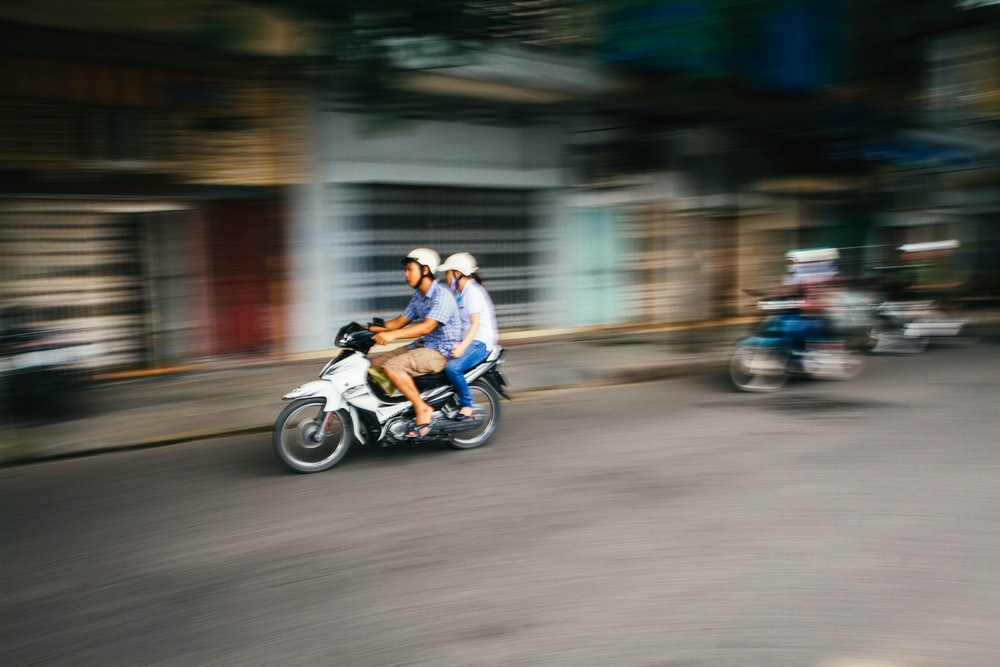 timelapse photo of people riding motorcycle