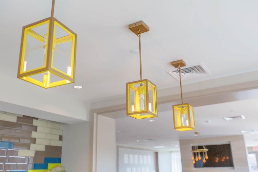 three yellow pendant lamps