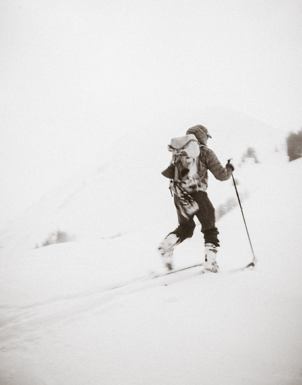 person hiking in snow mountain