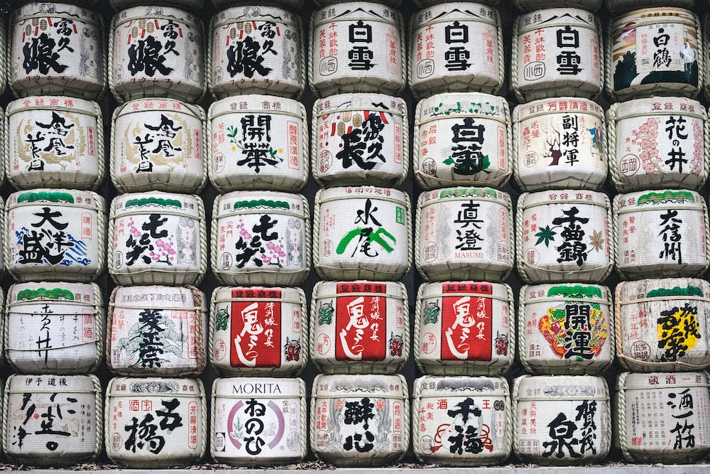 assorted white jar with kanji texts