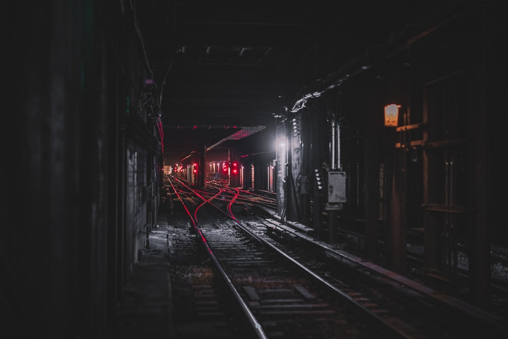 photography of railroad during nighttime