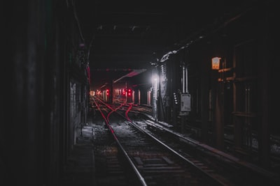 photography of railroad during nighttime dark teams background