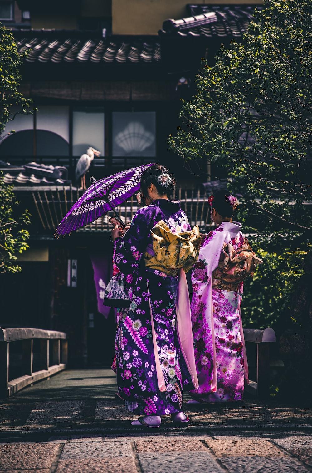 two women in purple and pink kimono