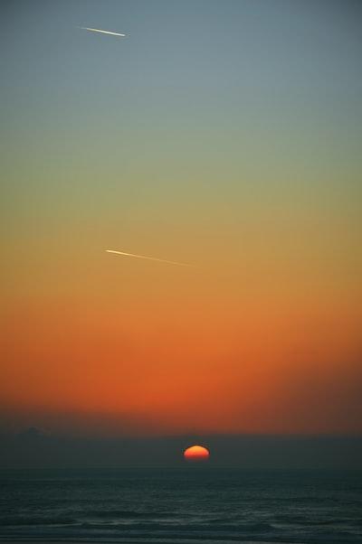 Shooting stars and setting sun