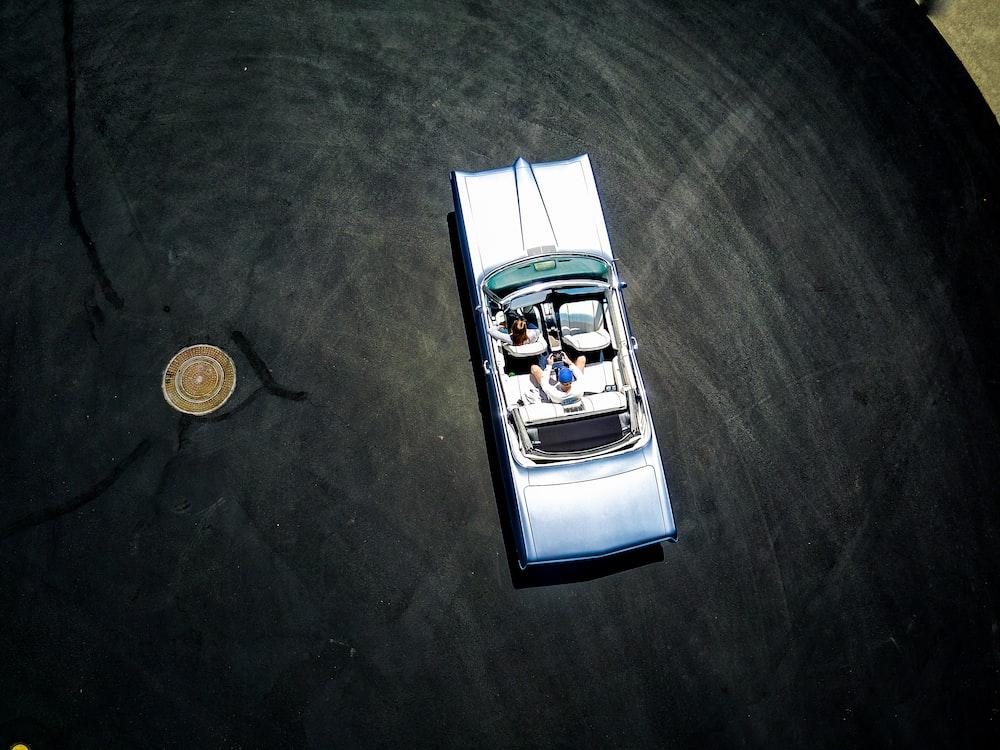 toy car near coin on table top
