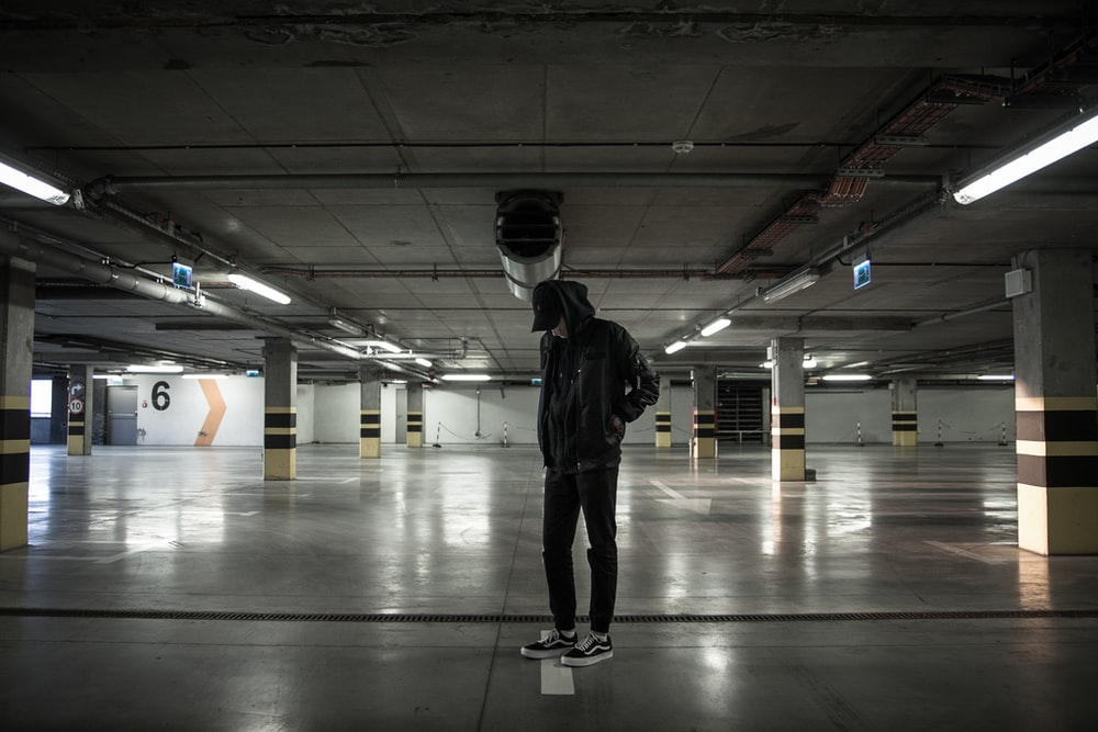 man standing in parking lot