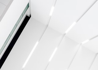 closeup photo of white wooden wall