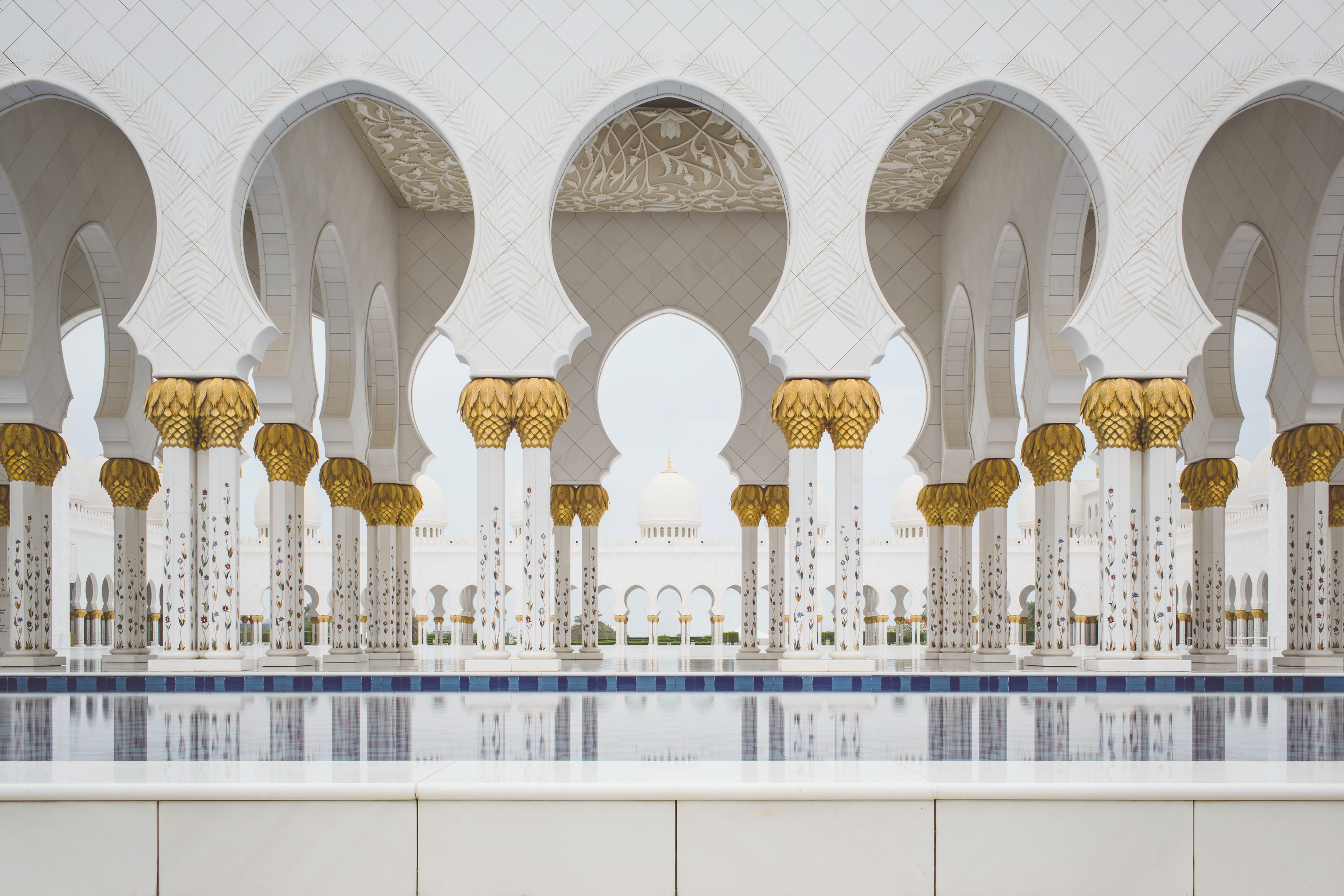 Beautiful white columns in the Sheikh Zayed Grand Mosque in Dubai