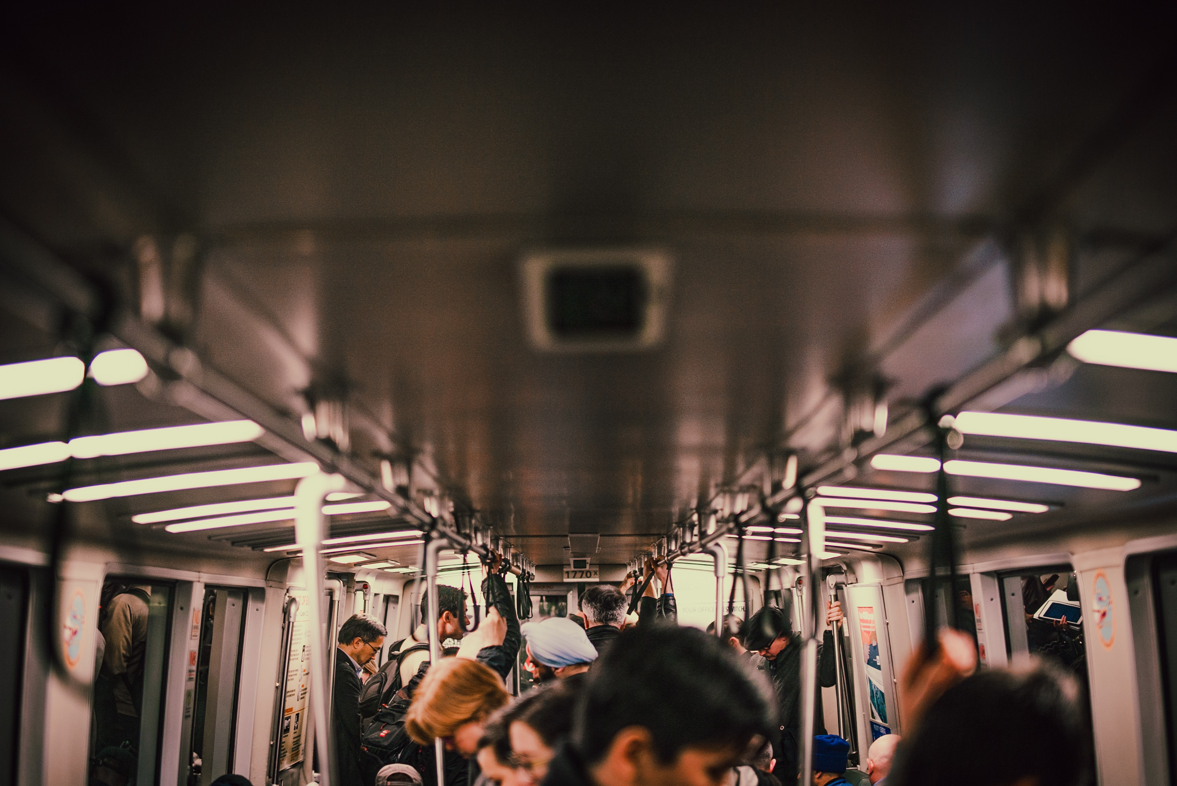 The interior of a crowded subway train