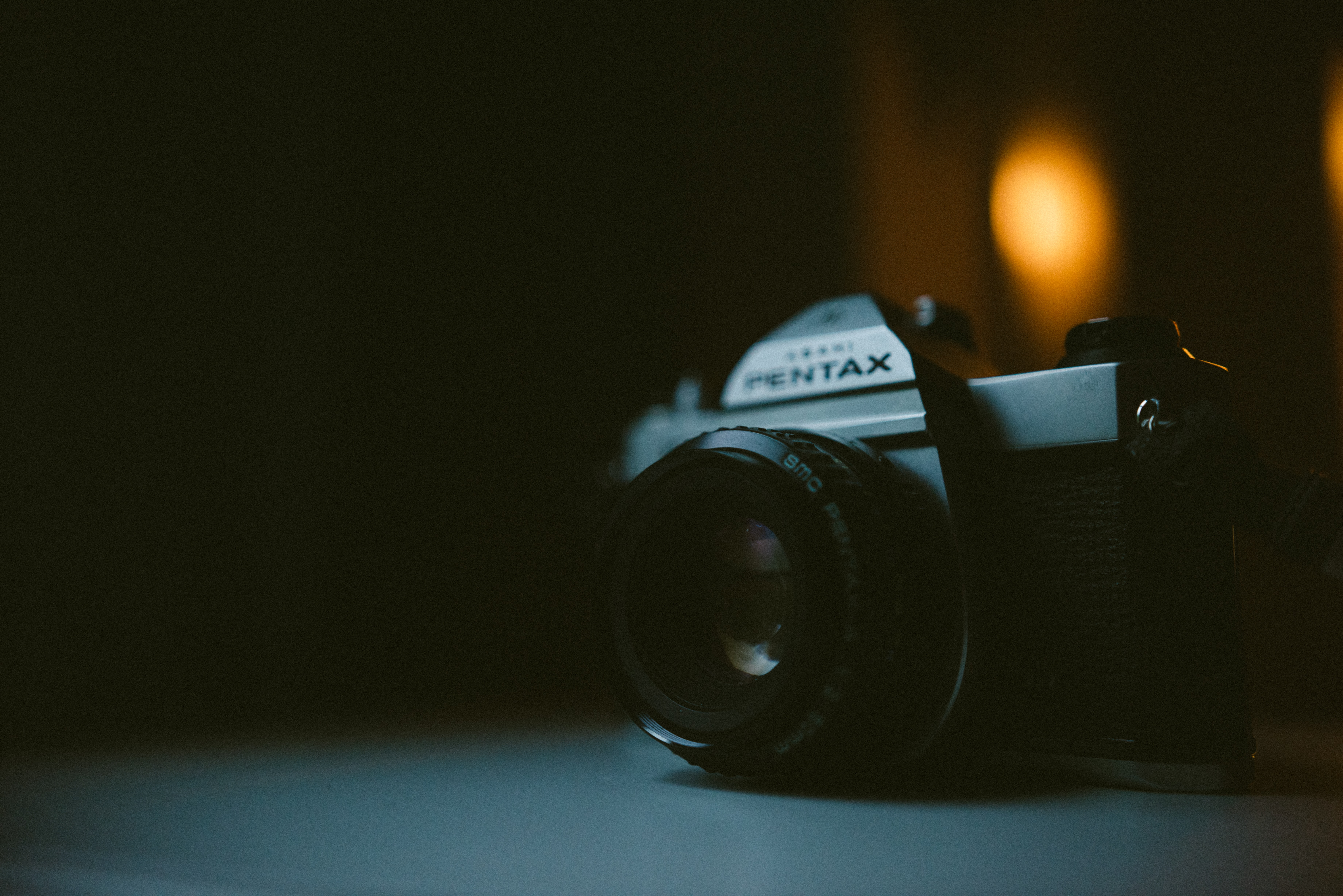 silver Pentax DSLR camera