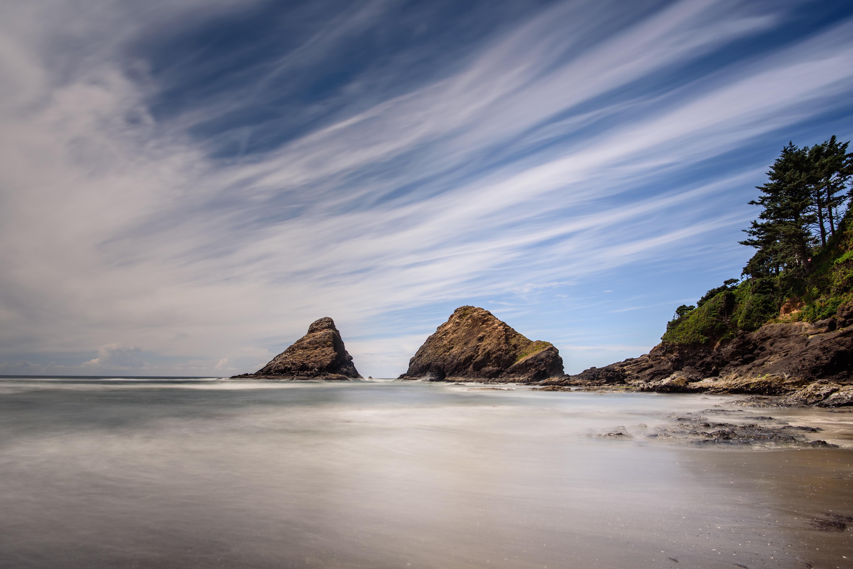 A scenic outdoor shot of the ocean shore at Heceta Beach in Oregon