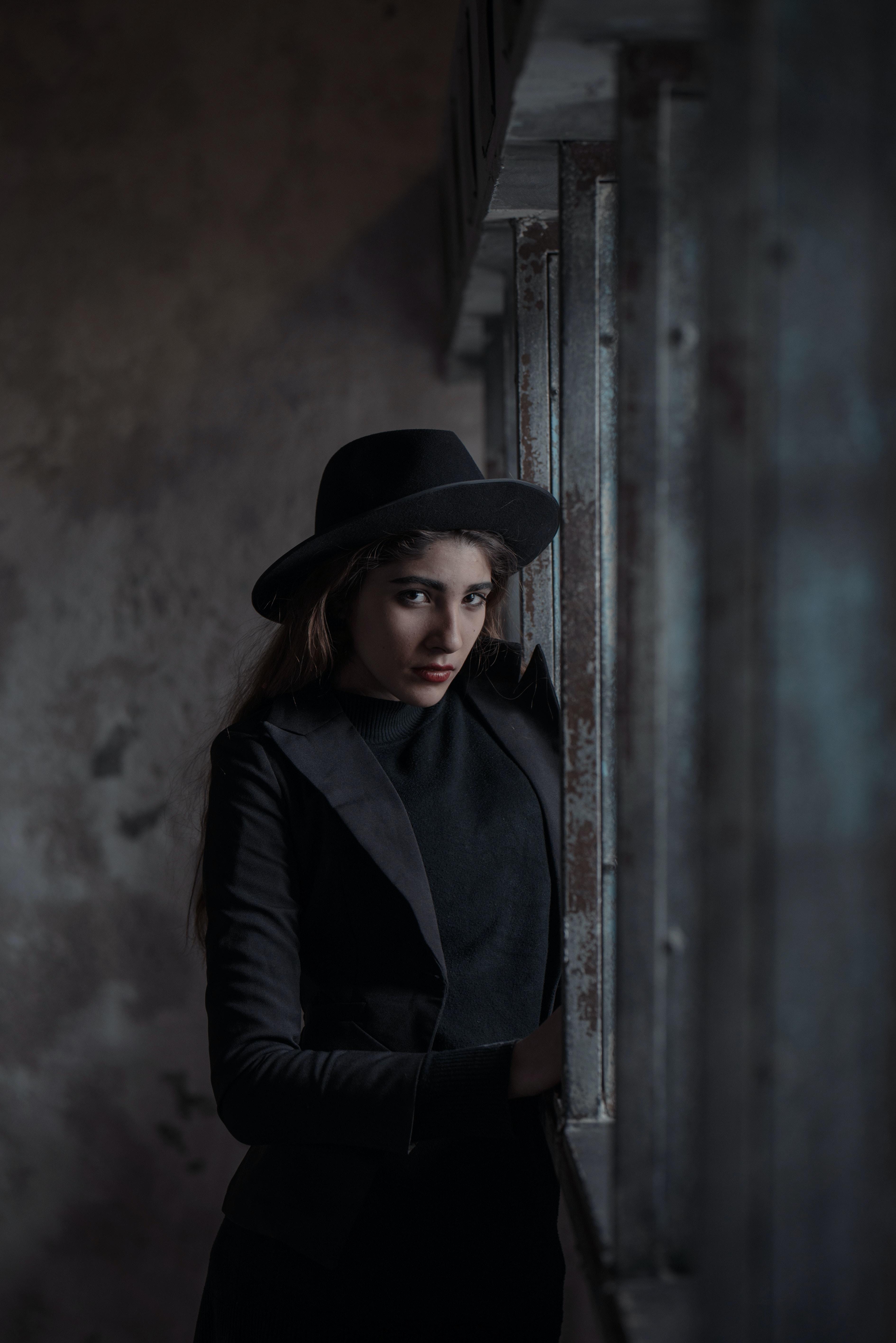 woman standing beside steel fence