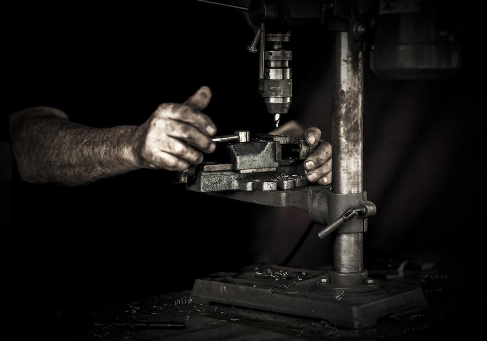 man using drill press