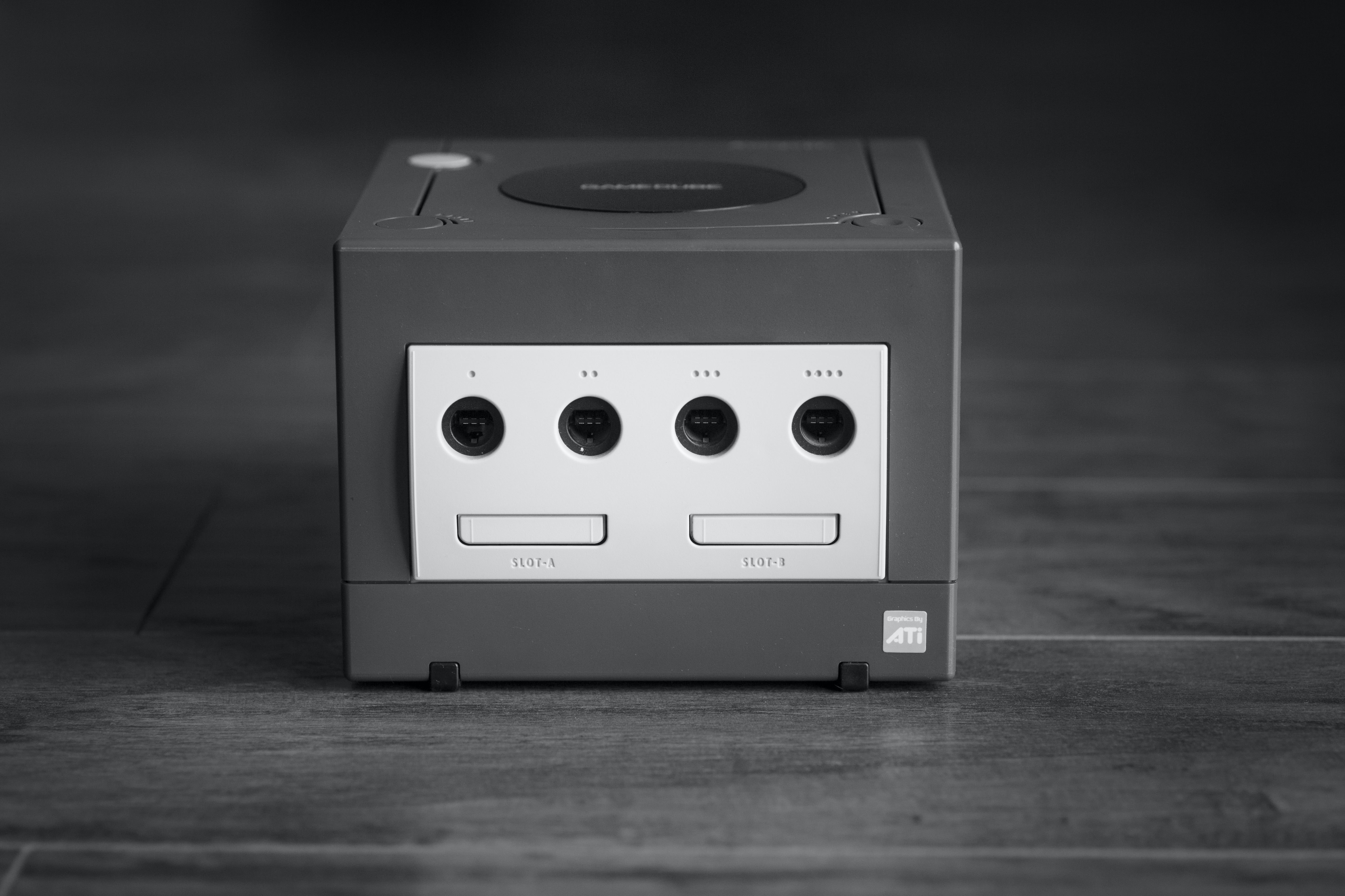 Black and white front of Gamecube gaming system with inputs and buttons