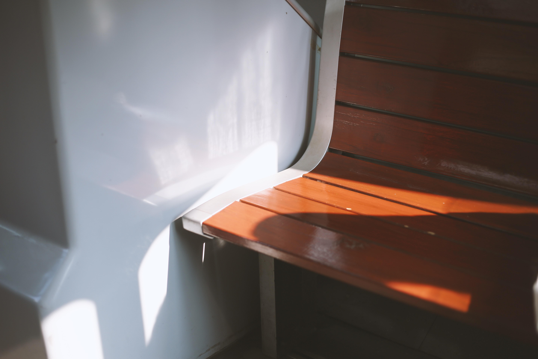 empty wooden chair near wall