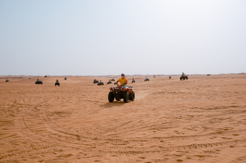people riding ATV's
