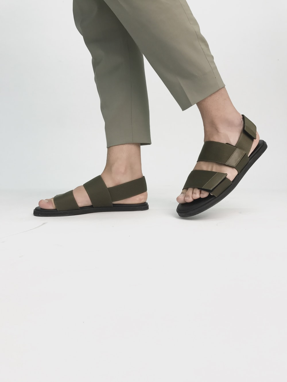 person in black velcro sandals