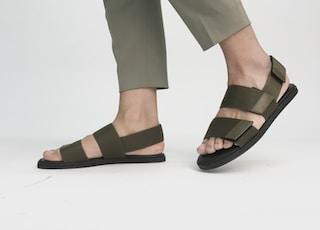 person in black velcro sandals