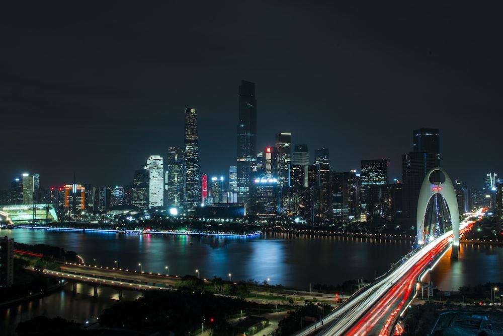 landscape photography of bridge near high-rise buildings