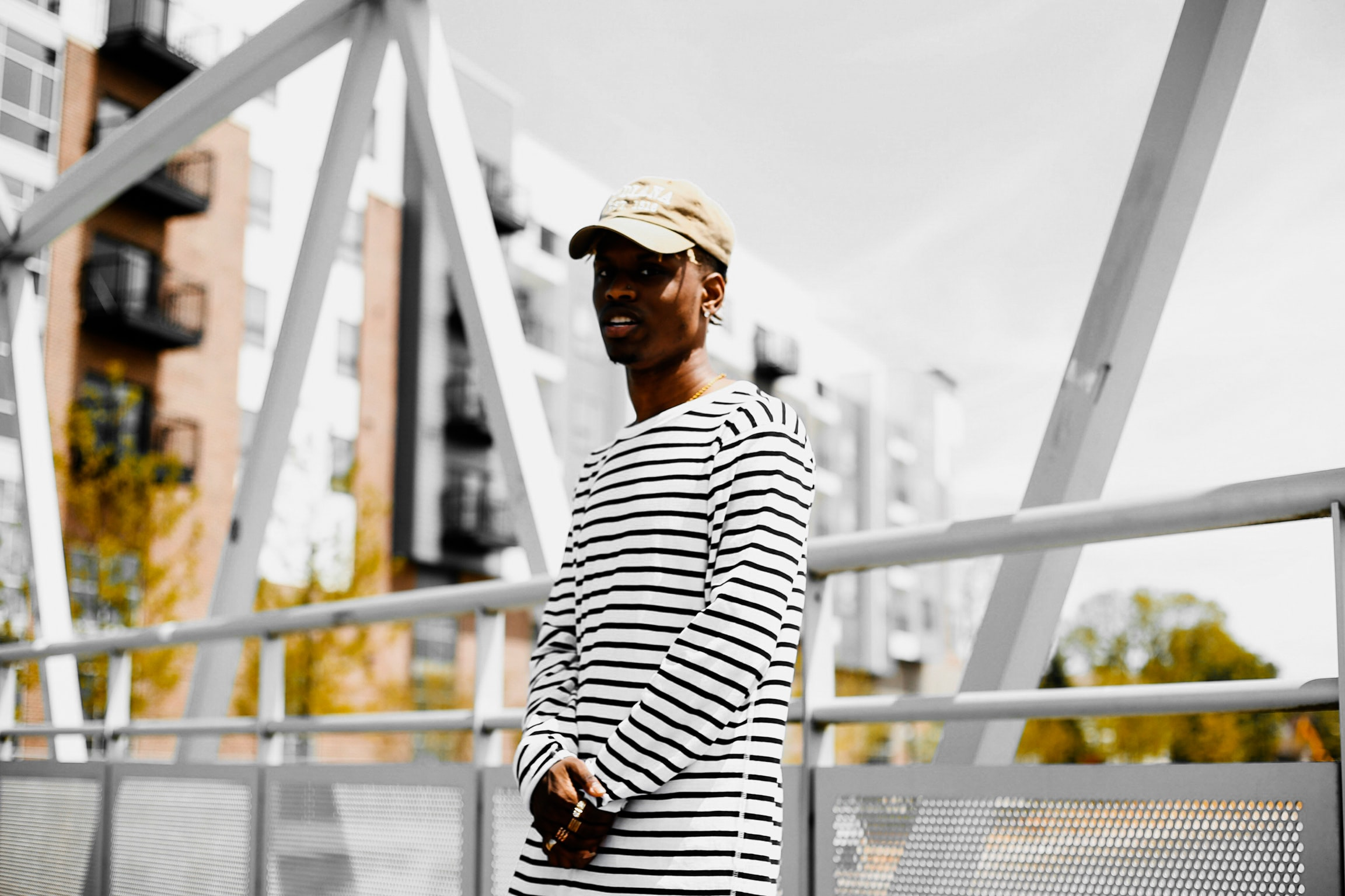 man lean on bridge rail