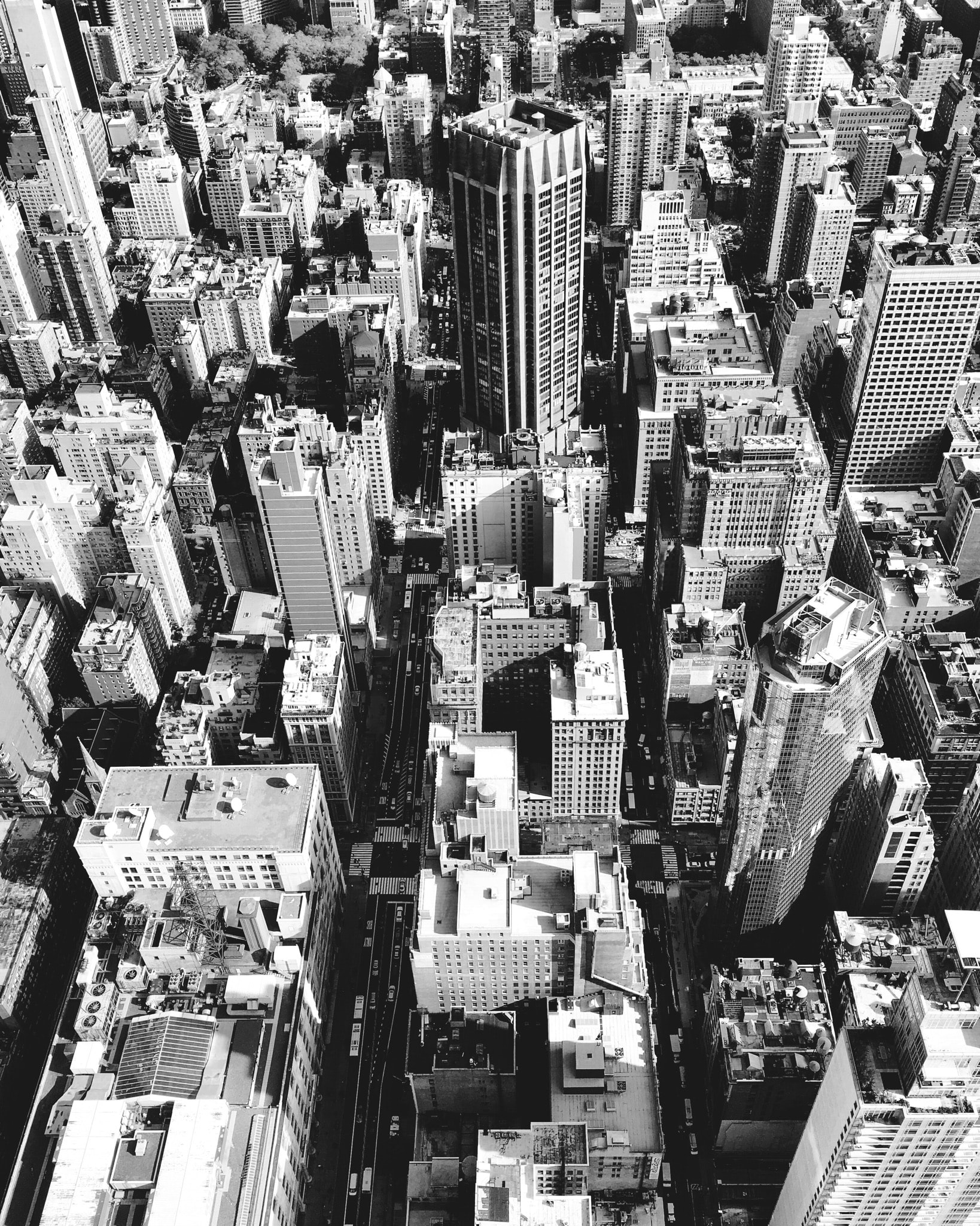 Black and white drone shot of city buildings and skyscrapers