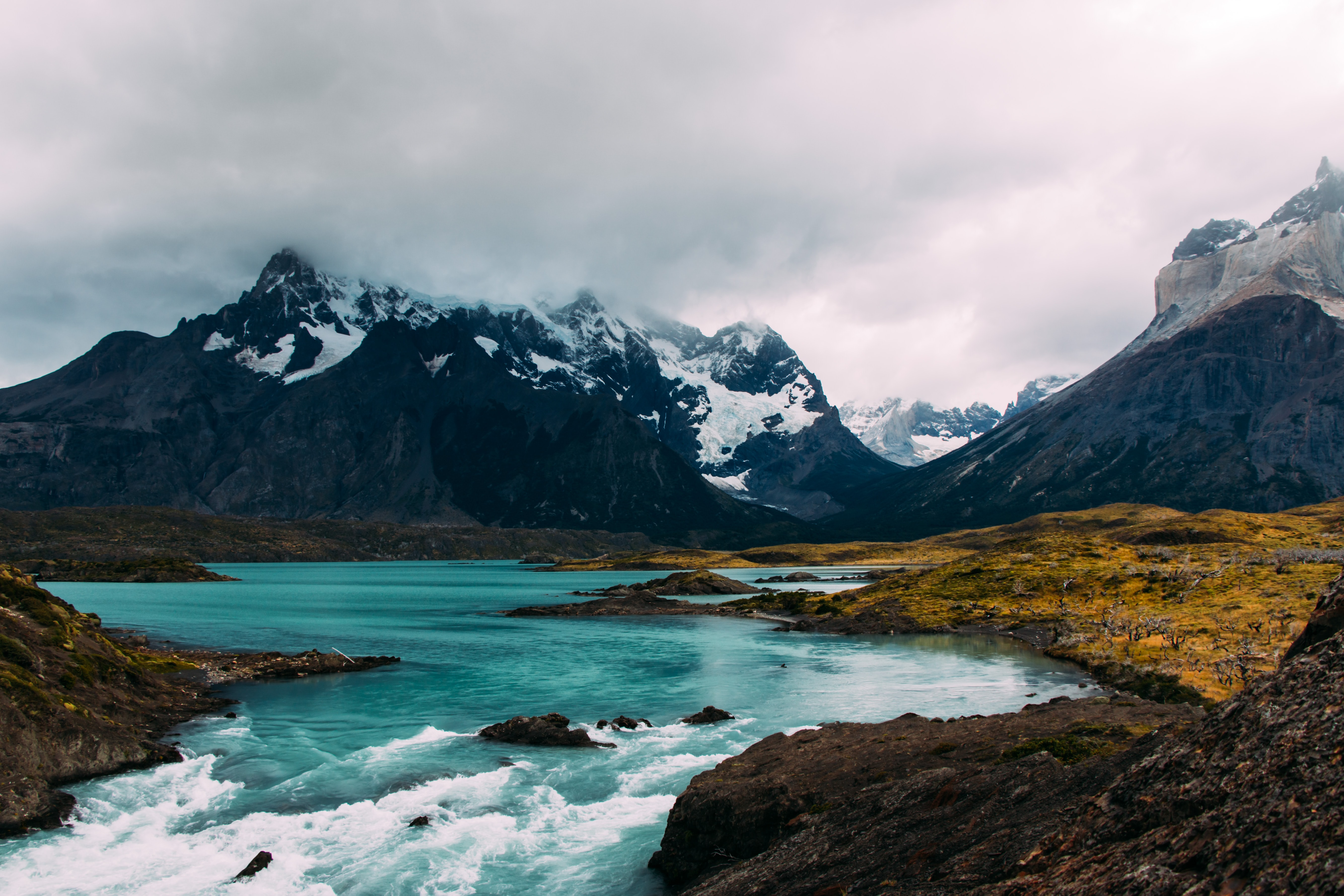 body of water surrounded by mountains