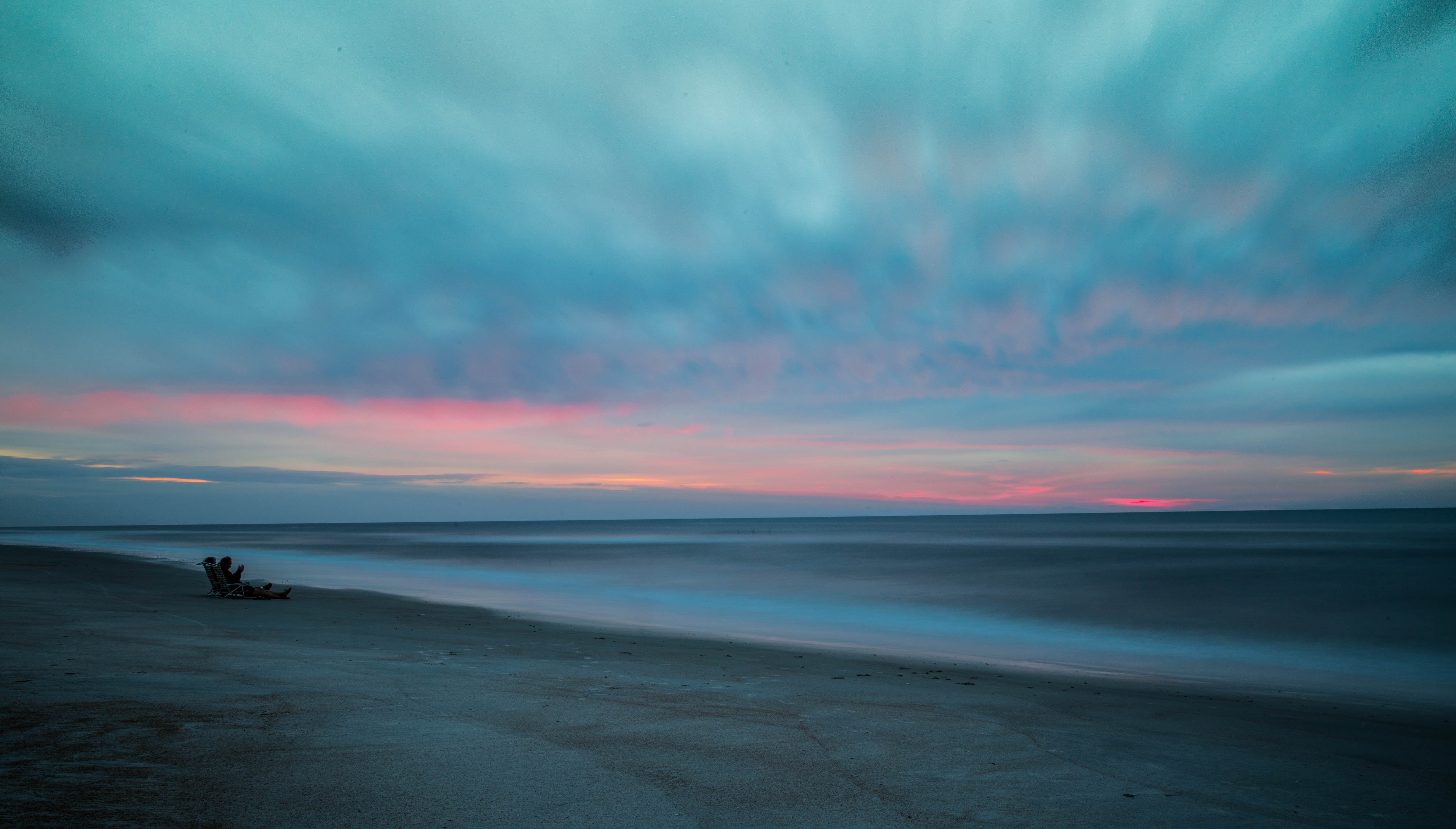 People on the sandy beach after the sunset at Saint Augustine Beach