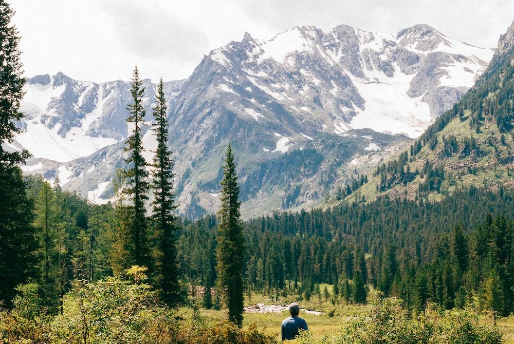 man standing near forest