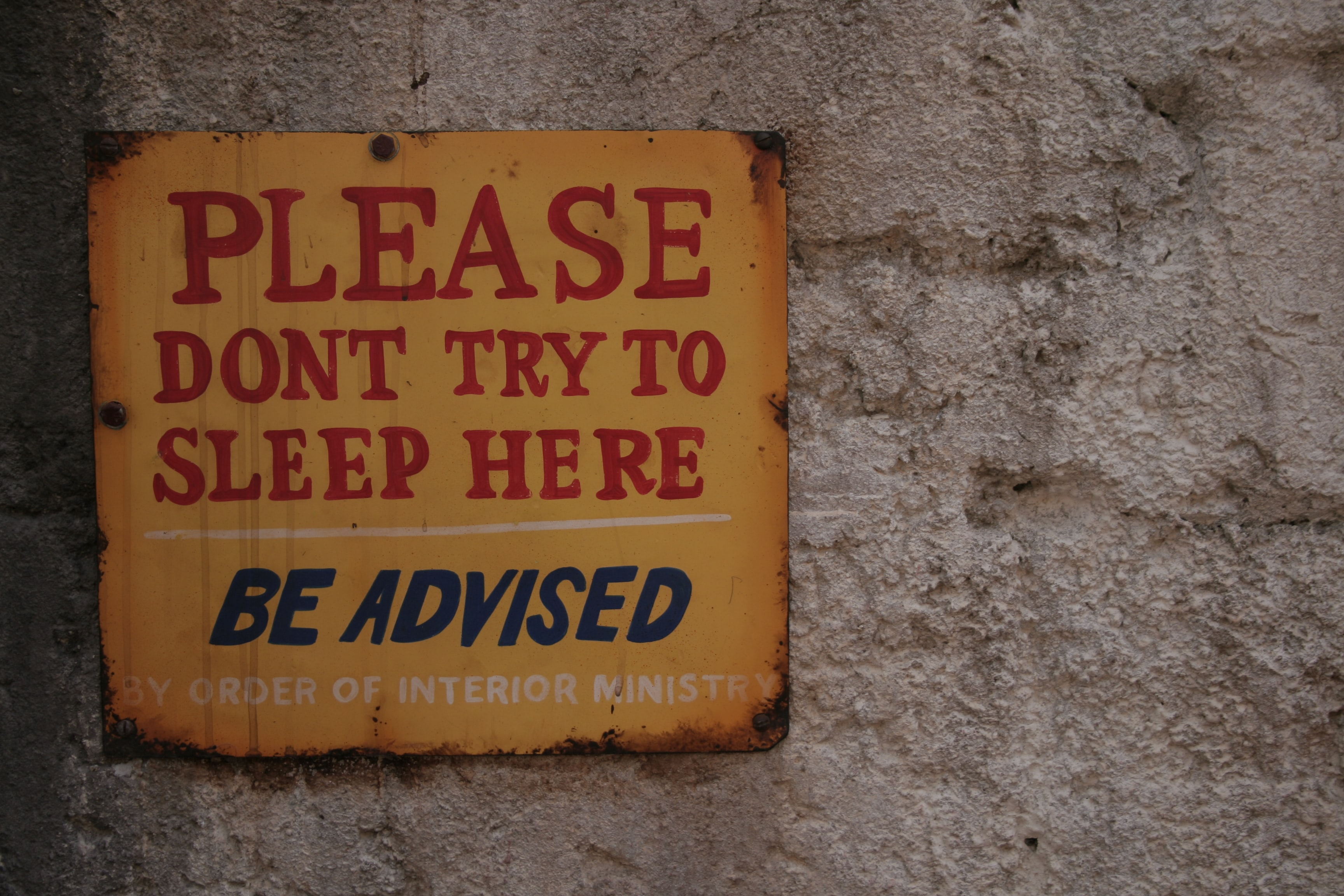 please dont try to sleep here signage