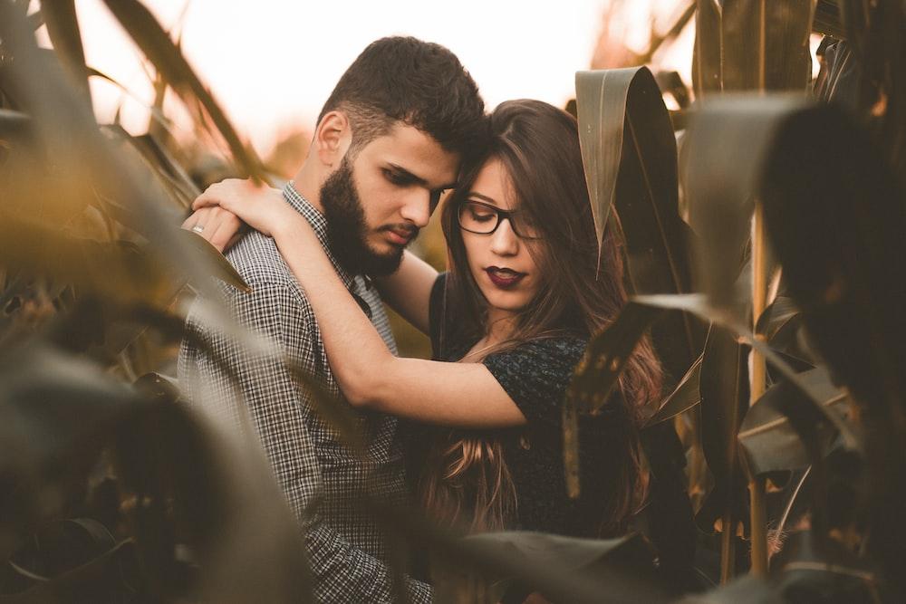 woman hugging man at the corn field