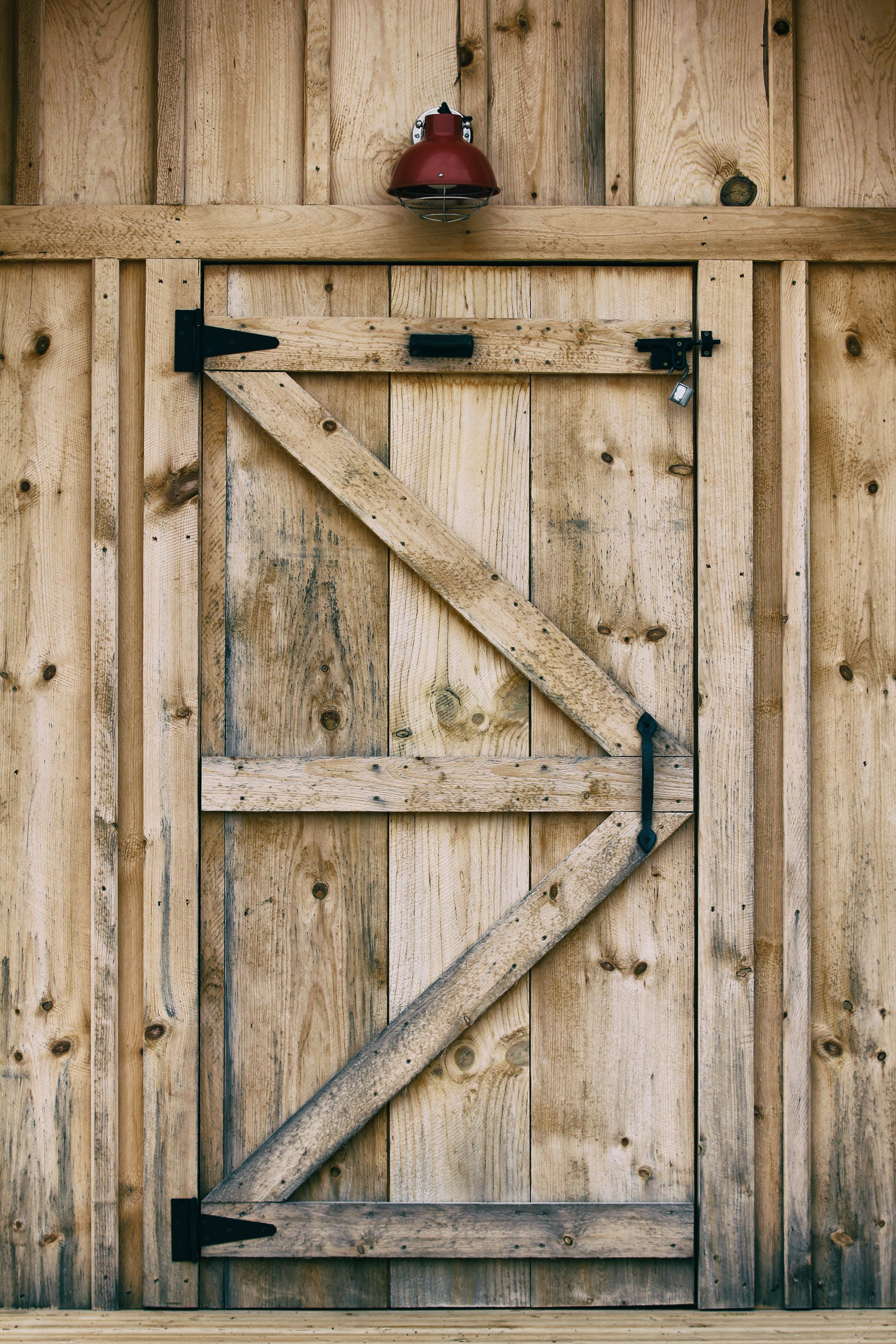 A wooden barn door with a red light above it in Parry Sound