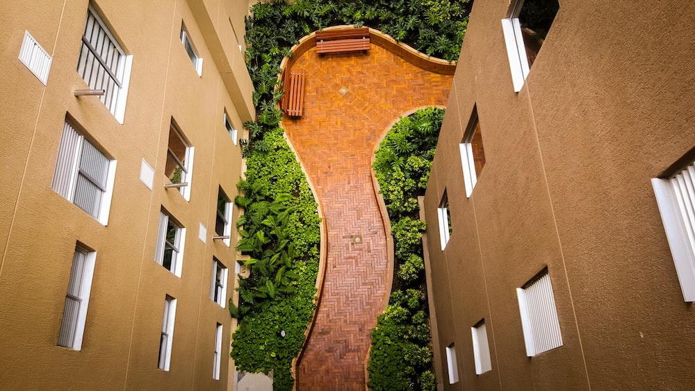 tiled pathway between buildings