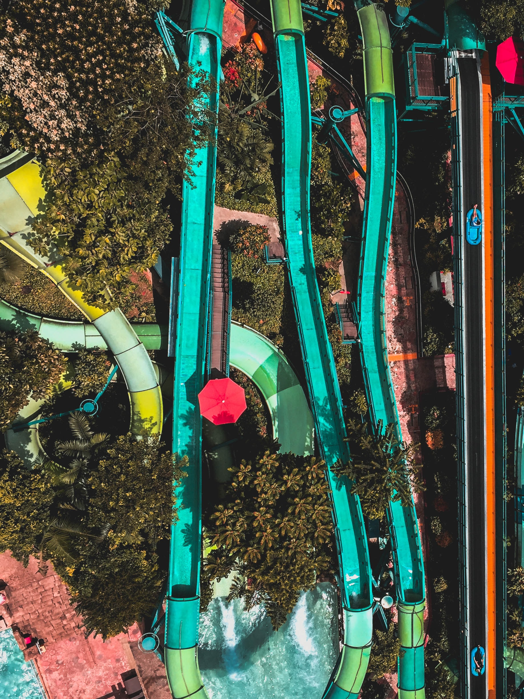 Drone aerial view of the colorful water slides from a Singapore Cable Car