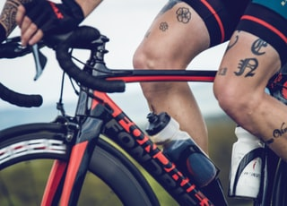 man riding red and black Fondriest bicycle