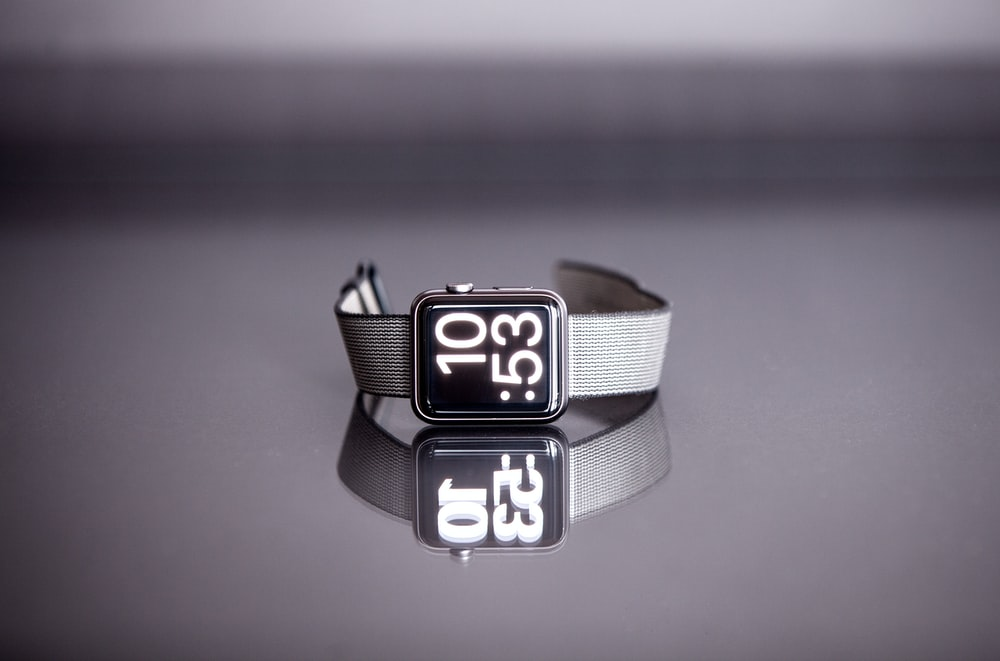 silver titanium Apple Watch with gray nylon strap