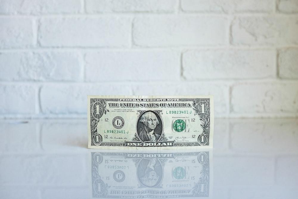1 U.S. dollar banknote on white surface