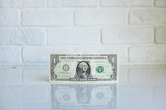 1 U.S. dollar banknote on white surface