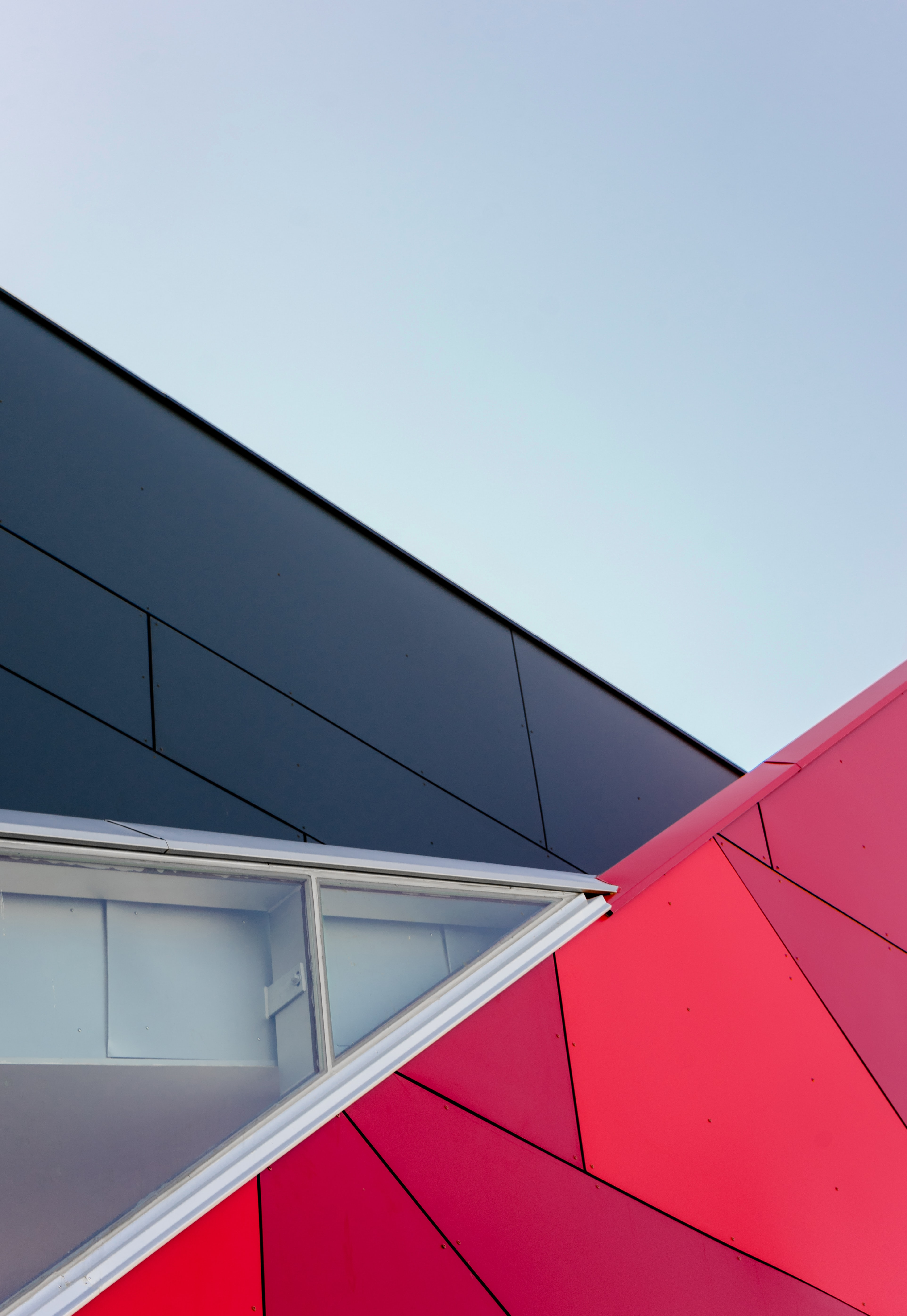 A black and red building with geometric angles and patterns