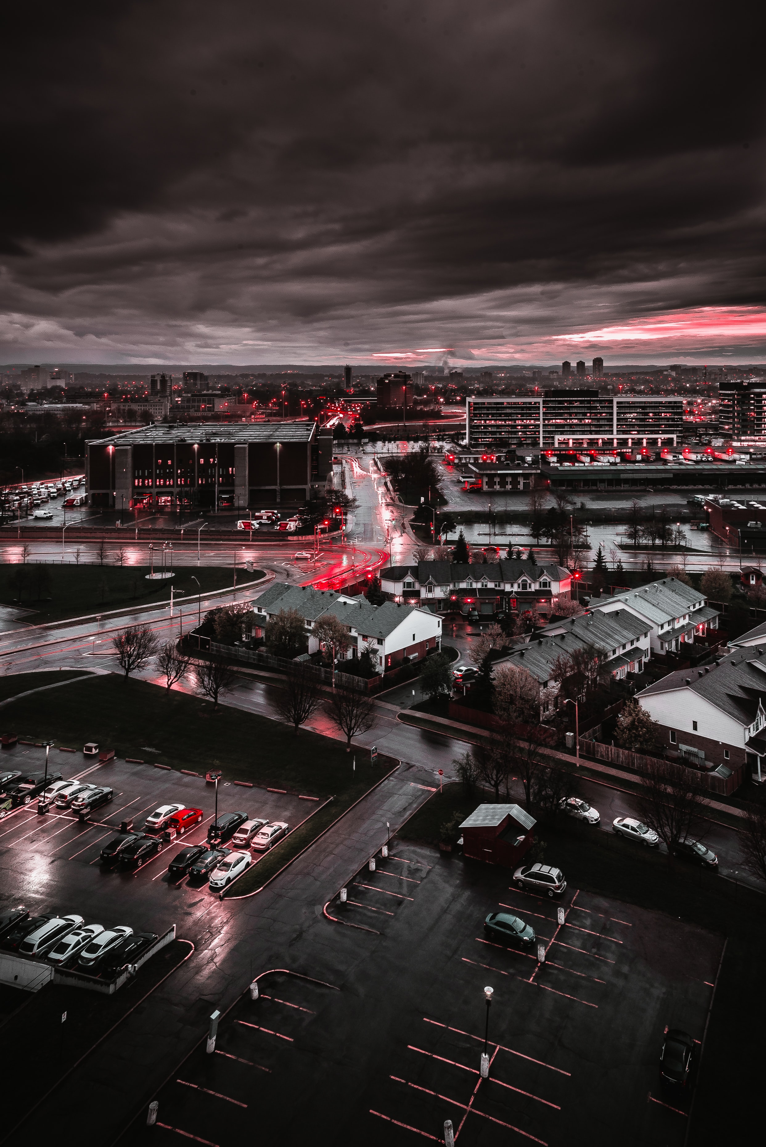 city buildings and cars on grayscale photography
